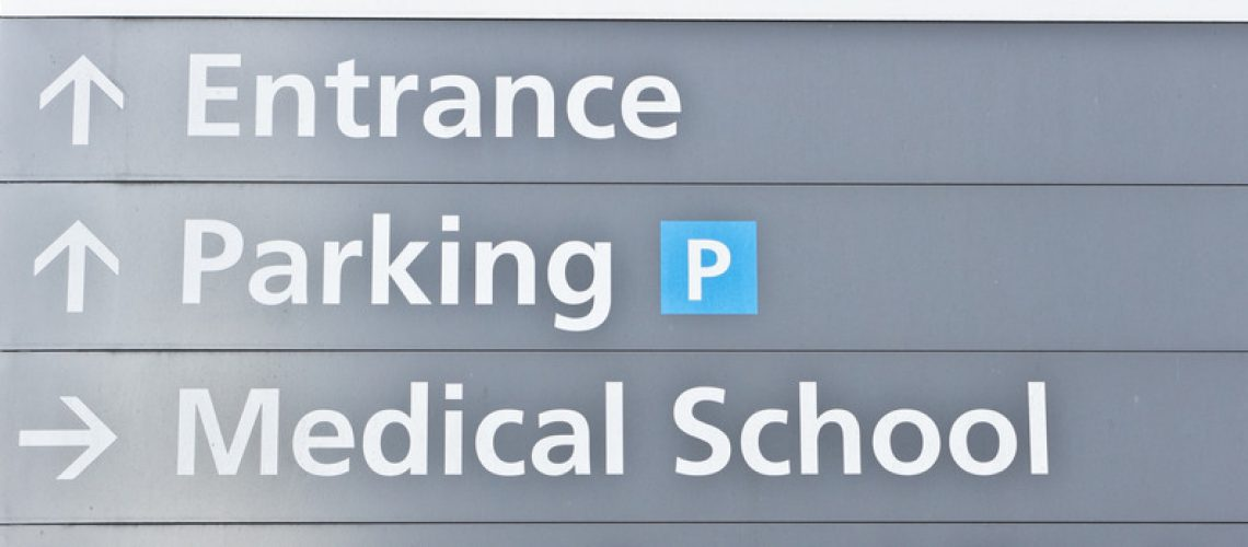 Grey sign post for a medical school